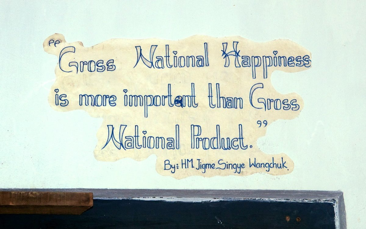 """Gross National Happiness is more important than Gross National Product"" by Jigme Singye Wangchuck, King of Bhutan. Slogan on a wall in Thimphu's School of Traditional Arts"