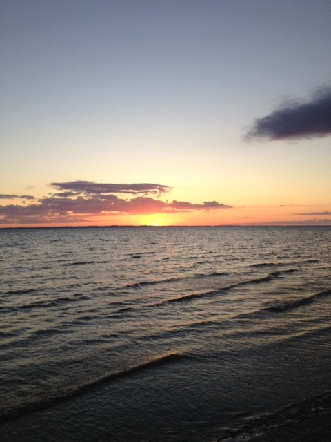 Photo of Traverse City sunset by Rick Bellingham