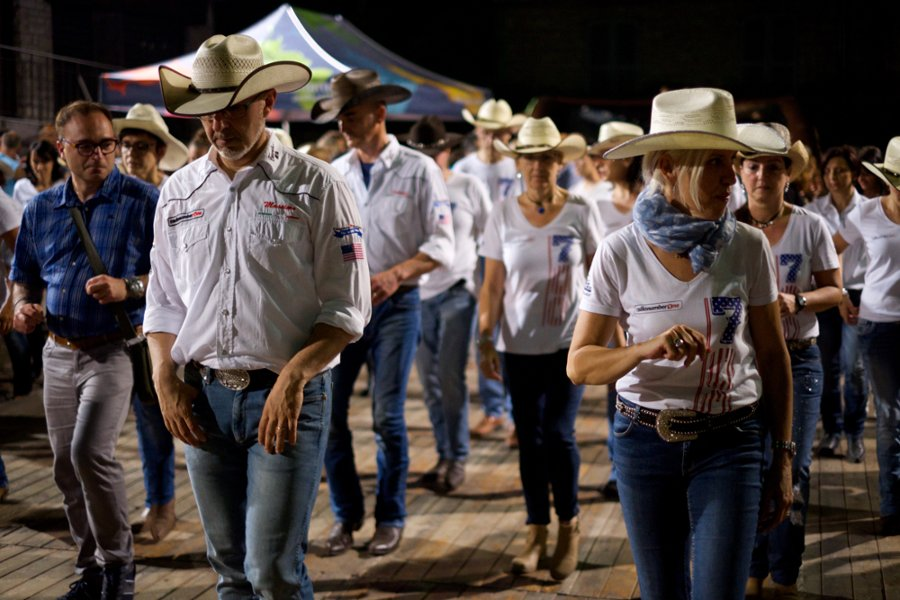 Title: Line dancing in Esino Lario | Author: Sebastiaan ter Burg on Flickr | License: CC BY 2.0