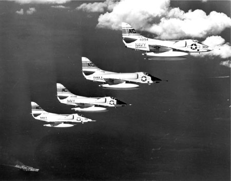 "Four Douglas A4D-2 Skyhawk (BuNo 144894 in front) from Attack Squadron 34 (VA-34) ""Blue Blasters"" in flight. VA-34 Det.45 was assigned to Carrier Anti-Submarine Air Group 60 (CVSG-60) aboard the aircraft carrier USS Essex (CVS-9) for a short deployment to the Caribbean from 3 to 29 April 1961. The aircraft flew sorties over combat areas during the Bay of Pigs Invasion, Cuba, on 17–19 April 1961. Author: Robert L. Lawson 