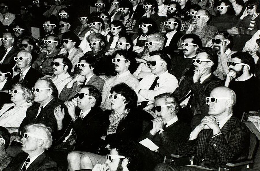 Title: Theater audience wearing 3-d glasses | Author: Burns Library, Boston College | Source: bc-burnslibrary on Flickr | License: CC BY-NC-ND 2.0