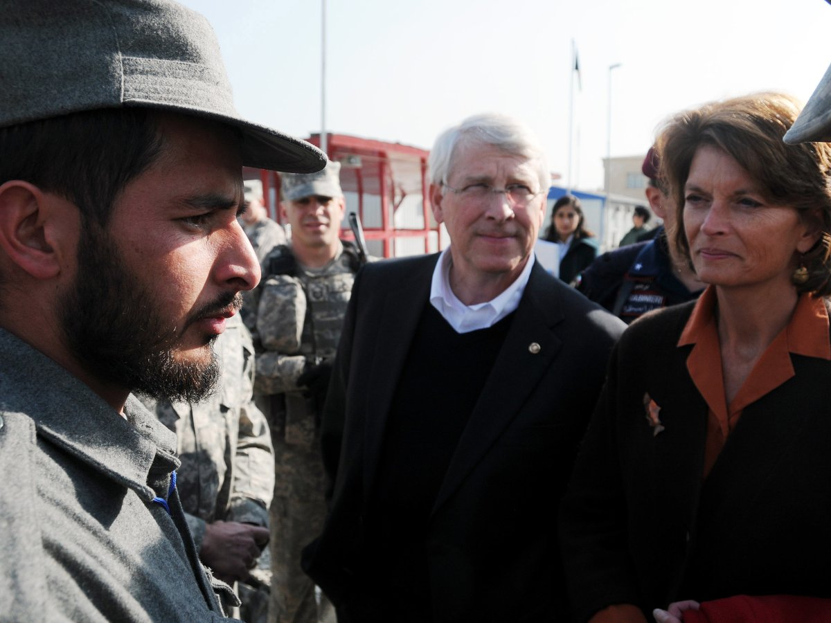 Title: U.S. Senators Lisa Murkowski and Roger F. Wicker speak with an Afghan Nation Police Officer at the Central Training Facility | Author: F. Julian Carroll | Source: NATO Training Mission-Afghanistan | License: CC BY-SA