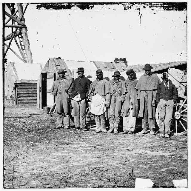 African Americans, freed from plantation slave holders, worked as teamsters at Bermuda Hundred to help the U.S. forces that freed them from the rebels of the civil war. | Credit: Hirst D. Milhollen and Donald H. Mugridge